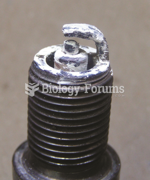 A spark plug from an engine that had  a blown head gasket. The white deposits could be from the ...