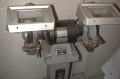 A typical pedestal grinder with a wire wheel on the left side and a stone wheel on the right  side. ...