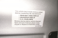 Placard near driver's door, including  what devices in the vehicle contain mercury.
