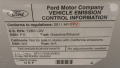 A vehicle emission control information (VECI) sticker on a flexible fuel vehicle.