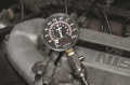 """After the engine has been cranked for four """"puffs,""""  stop cranking the engine and observe the ..."""