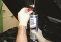 Hang the canister from the vehicle's hood and adjust  the air pressure regulator to full OPEN ...