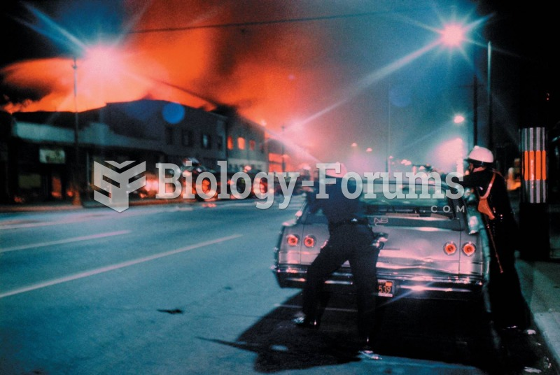 Police officers take aim during the riots that swept through the Watts section of Los Angeles in ...