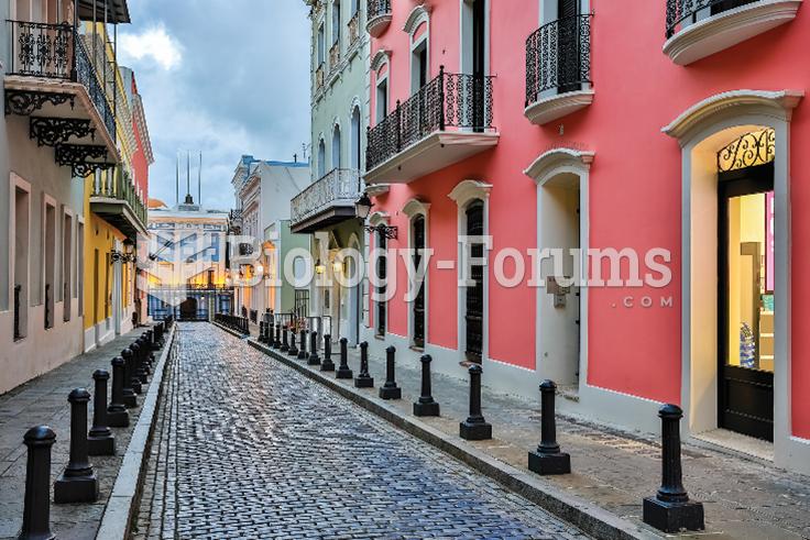 A long, narrow cobbled street in Old San Juan.