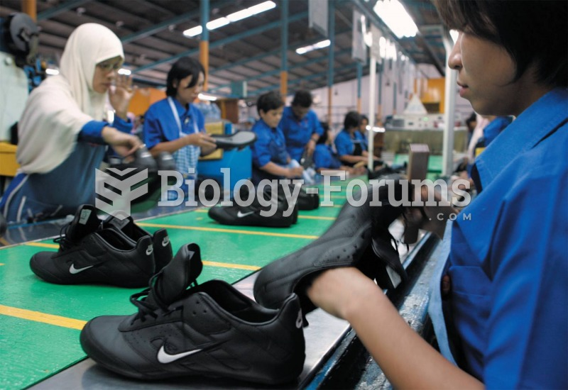 Workers at a Nike factory in Indonesia insert soles into sneakers for fourteen cents an hour.
