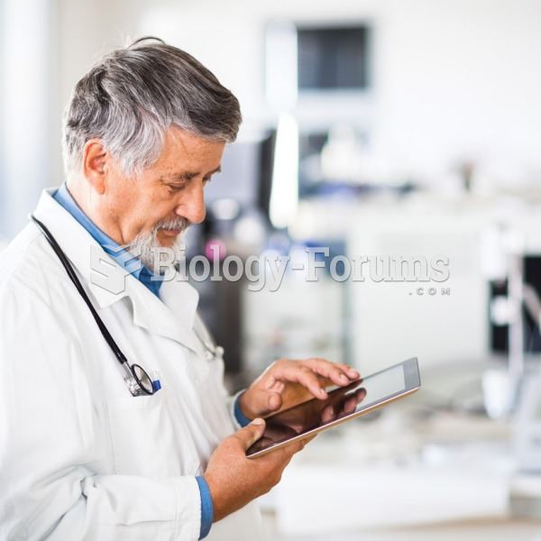 A physician uses a portable electronic tablet to enter patient data while in the examination room.