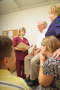 The patient and his family meet with the nurse to discuss progress on the patient care plan.