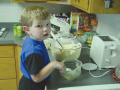 Preschoolers benefit from helping with meal preparation, especially with foods they like