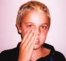 """Young boy with characteristic nasal crease from the repeated action of the """"nasal salute"""" caused ..."""