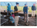 Biological anthropologists map skeletal remains from a prehistoric site.
