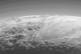 Close-up view of Pluto's mountains, frozen plains and hazes