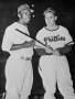 In this photo opportunity, Phillies manager Ben Chapman refused to shake Jackie Robinson's hand. ...