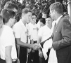 "Young Bill Clinton (left) shakes hands with President John F. Kennedy. ""The torch has been passed ..."