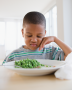Serving unfamiliar foods repeatedly and asking the child to try a bite can lead to gradual ...